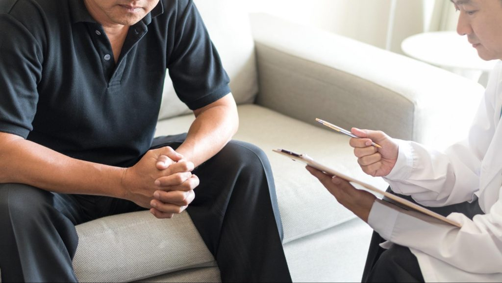 A urologist speaking with a male patient