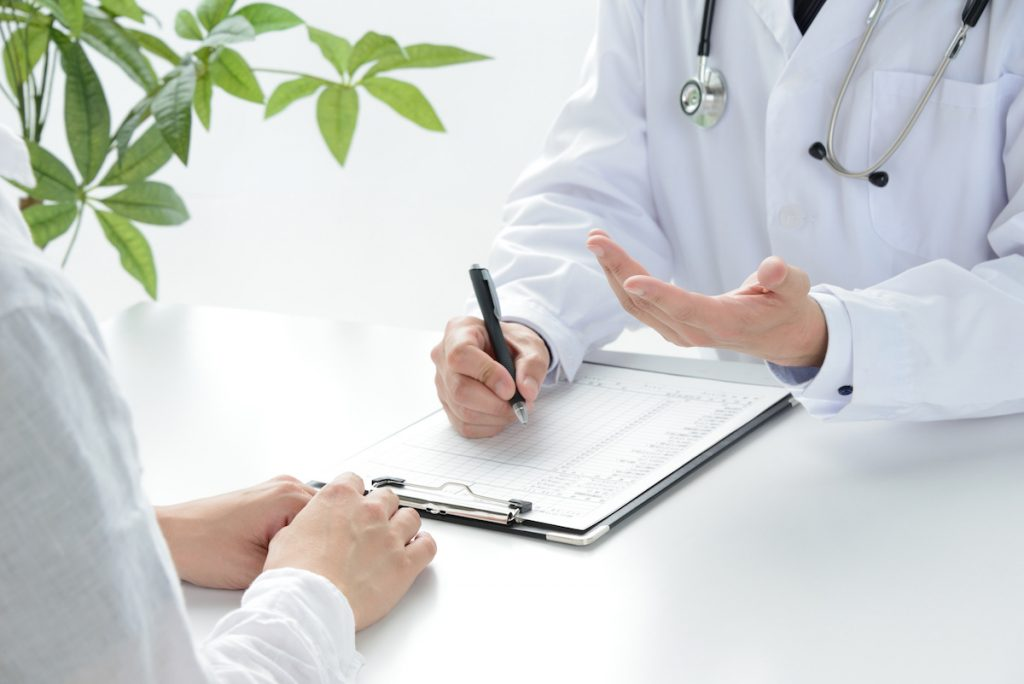 A urologist meeting with a patient