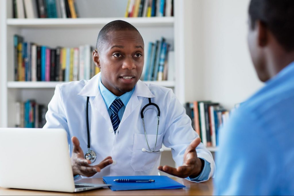a male doctor explaining the top questions about seo to his patient